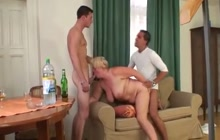 Old woman and younger guys in a threeway