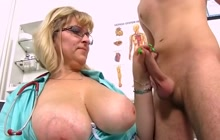 Monster boobed mature nurse playing with a young cock