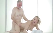 Sweet blonde massages older man