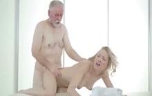 Sweet blonde massages older man