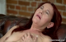 Busty redhead granny loves to fuck with a big cock