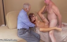 Young girl having fun with 2 mature dudes