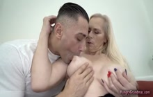 Horny stud screwing with big titted blonde granny