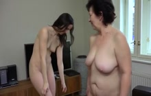 Old lady and sexy brunette in action